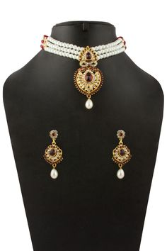Golden Studded Necklace with Jhumka earrings. New Designer Dresses, Designer Sarees Online, Designer Wear, Indian Necklace, Raksha Bandhan, Buy Dresses Online, Necklace Online, Matching Necklaces, Diwali