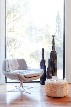 Reading nook by 18KARAT, featuring the PERCH swivel chair, CAVA bottle vases and HYACINTH stool.