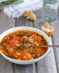 Quinoa Chickpea and Spinach Soup- a hearty soup vegetable soup that's packed with protein! Sub extra broth for the white wine, and use 2 cups of chickpeas to serve 4 for Phase 1 (no oil, and serve with an extra 1/2 grain serving) and Phase 3.