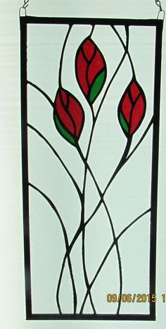 Stained Glass Rosebud Panel, Stained Glass Roses, Rose Panel, Glass Art, Window Panel by TheBlueEmporium on Etsy https://www.etsy.com/listing/400600527/stained-glass-rosebud-panel-stained