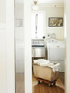 what i love about this laundry room: the vintage, industrial cart, the sisal rug, and that laundry sink!