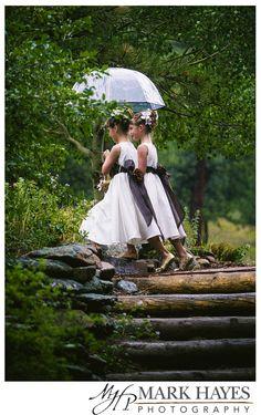 Flower girls on rainy wedding day