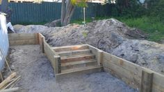 Pine sleeper retaining wall with stairs, prior to backfilling and staining.