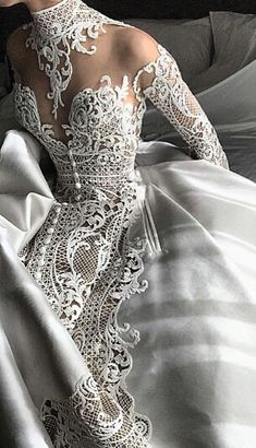 We love this extravagant lace design! #weddingdress #bride #wedding #laceweddingdress #weddingdresses #uniqueweddingdress