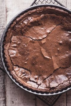 This gluten free Belgian Chocolate Cake is one of the easiest flourless chocolate desserts I make ~ it has a thin crisp crust and an impossibly silky chocolate interior!