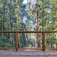 Santa cruz backyard cottage deck railing hog wire metal, Backyard cottage metal siding, kitchen tile, metal stair case, wood ceiling, metal fence, hog wire fence, wood floors, metal roof, water storage, counters, custom cabinets, master bath, master bed, barn door, accessory dwelling, guest house, custom home, architecture, sustainable, kitchen sink, retro, deck