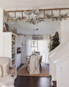 """We started decorating that hanging ladder of ours for Christmas! We used some garland from @michaelsstores, a wreath from @homegoods, & some lovely string…"""