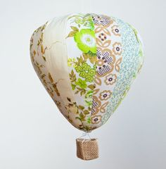 A single handmade hot air balloon designed to float gently in your desired space. For Godsakes it FLOATS!