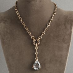 Y-neck with textured chain, engraved donut center and pear shape rock crystal gemstone drop