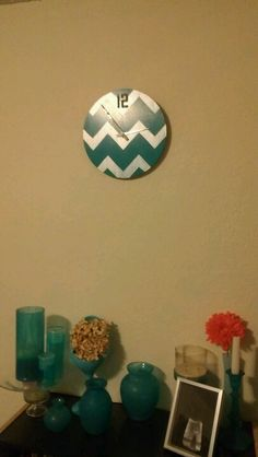 I had to have something chevron ;) upcycled a wooden clock and painted thirft store finds with martha stewart craft paint to match my bedrooms teal color scheme.