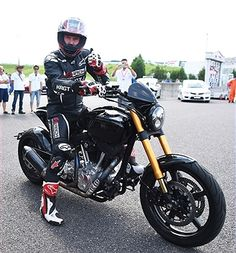 Keanu Reeves test-rides his Arch Motorcycle during the Suzuka 8 Hours at the Suzuka Circuit on July 25, 2015 in Suzuka, Japan.