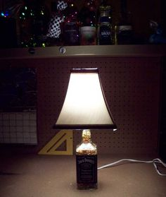 DIY Project - How to turn a recycled glass bottle into a bottle lamp. Video of 'How to make a Jack Daniels Bottle Lamp' with step by step instructions.
