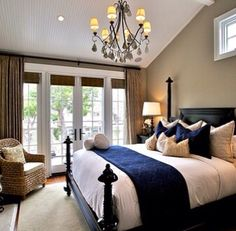 Navy blue, white and metalic bed, lighter walls