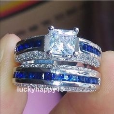 White & Blue Sapphires 14 KT Gold Filled Ring Set PRE ORDER ONLY  Princess cut white sapphire center stone, channel set blue sapphires with pave set white sapphires. 14 KT white gold filled mounting.  Marching band has channel set sapphires with pave set white sapphires.  PRICE INCLUDES BOTH RINGS Jewelry Rings