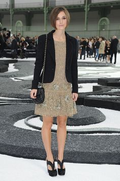 Keira Knightley Day Dress  Keira showed off her tweed embroidered dress while hitting the Chanel Spring 2011 fashion show.   Brand: Chanel