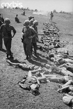 30 Oct 1965, Da Nang, Vietnam — U.S. Marines inspect bodies of Viet Cong killed during attack October 30th on Marine defensive position on the outskirts of the Da Nang Air Base. During the battle, a company of Marines, outnumbered 4-1, repelled the...