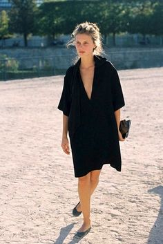 Paris Fashion Week Street Style: Marine Vacth in an effortless black dress, and ballet flats #style #fashion #frenchstyle