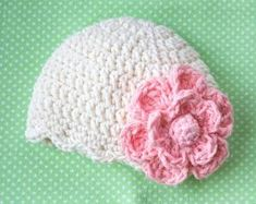 crochet baby hat with a big flower by rae