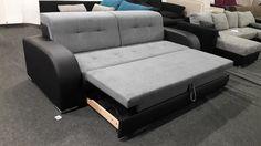Sevilla kanapé: ágyazható kanapé fekete textilbőr és szürke szövet kárpittal, króm lábakkal.