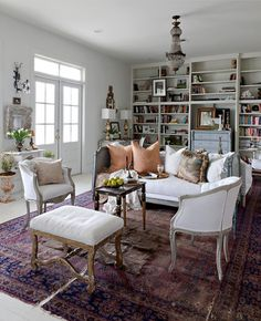 light gray on floors, shelves and ceiling + white muslin covering furniture + warm red oriental rug