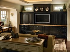 Java colored cabinets with lots of drawers and a desk in place of the tv cubby!