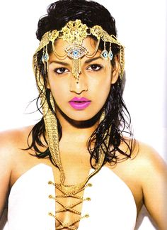 M.I.A. ~ where or where did she find that Evil-Eye Headgear at? Gaudy & Gorgeous!!