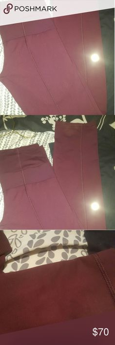 Lululemon double waist straight leg pants Size 8 Its the wine color everybody is crazy over took me forever to get them but never wear. Has a small spot below the leg behind the leg not noticeable but had to put in my listing. Doesn't have size inside took it out for comfort. Willing to trade to a pair of 10s my 8s just don't fit me any lululemon.Has size dot on back of leg. IN 3RD PIC IS THE LITTLE STAIN. NO PILING OR FUZZIES look over the bottom ill wash as soon as I sale Real SLEEK…