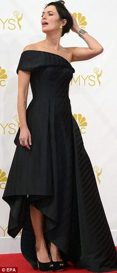 Dramatic: Game Of Thrones Lena Headey showed off her tattoos in a Rubin Singer off-the-shoulder black gown