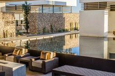Modern elements and natural textures blend to create a relaxing backyard oasis. Gabion Wall, Perfect Garden, Home, Modern Landscape Design, Modern Pools, Relaxing Backyard, Porch And Terrace, Modern Landscaping, Outdoor Furniture Sets