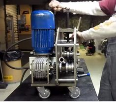 Tubing Roller by PSH1973 -- Homemade tubing roller constructed from an electric motor, gearbox, sprockets, chain, dies, steel plate, tubing, and casters. http://www.homemadetools.net/homemade-tubing-roller