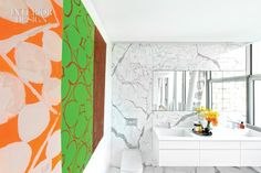 High Above the High Line: The HL23's Model Apartment Awes Chelsea | Statuary marble in the master bath complements a Judy Ledgerwood work in acrylic, oil, and gouache. #interiordesign #design #interiordesignmagazine #residential