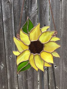Love this Happy Stained Glass Sunflower sun catcher, all the glass is cut by hand fitted, copper foiled and soldered together to a finished size of 10 inches tall by 8 inches wide. It comes with a copper chain ready to be displayed in your home.