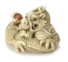 An ivory netsuke of a dragon By Yoshitomo, Kyoto, early 19th century