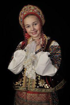 A smiling girl is wearing the Russian national costume and a kokoshnik. #cute #kids #Russian #folk