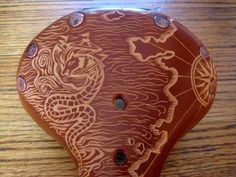 Leather Engraved Brooks Saddle Bicycle Seats By Kara Ginther --these are so cool.love the sea design! Bike Horn, Leather Engraving, Leather Bicycle, Bicycle Seats, Bike Storage, Brompton, Pedal Cars, Bike Parts, Bicycle Accessories