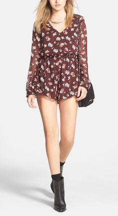 The chunky boots paired with this floral, flirty romper totally lends a hint of edge to an otherwise dainty ensemble.