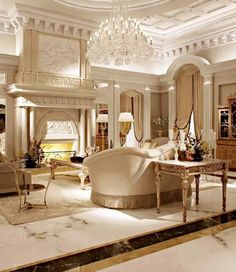 This is what captures classic interior design. The intricately carved ceiling decor, classic white marble floors and dramatic chandelier