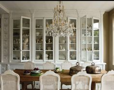 all my dishes and finery would look so lovely in this wall of cabinets! and how wonderful for holiday decorating!.