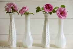 Flowers in thrifted milk glass vases