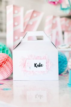 The TomKat Studio | Kate's Cotton Candy Party! Party Favors in Gable Boxes topped with Fringe Garland and a Custom Name Tag!