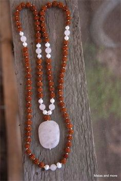 Rose Quartz mala with freshwater pearl accents. Express your love.