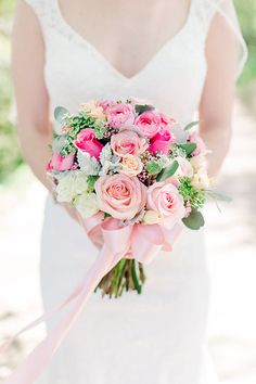 Emily's bouquet: local ranunculus, nena, paloma and celestial roses, wax flower, dusty miller, silver dollar eucalyptus, and queen anne's lace. Designed by Flowers from the Rafters : Photo by Janne Photography