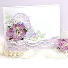 Create a dramatic and gorgeous card using Spellbinders Card Creator Border Dies.  Plus learn a cool background technique.