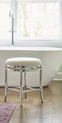 Freshen up in your master bath with service from our Bailey Vanity Stool. Polished stainless steel, plated in a sophisticated chrome finish exudes luxury, while the sleek cushioned seat with swivel function provides top performance.