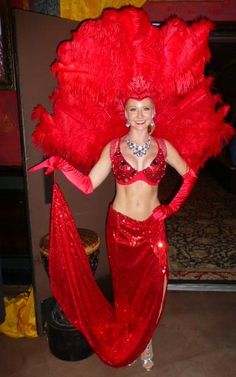 Our classic red showgirl made an appearance at the House of Blues corporate event this past week.  feathers, costume, Las Vegas, Houston model, ISES Houston, Texas Entertainment Company www.jdentertain.com