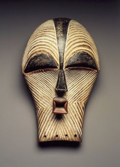 Songye. Female Kifwebe Mask, late 19th or early 20th century. Wood, pigment, 12 x 7 1/8 x 6 1/8 in. (30.5 x 18.1 x 15.6 cm). Brooklyn Museum, Collection of Beatrice Riese, 2011.4.2. Creative Commons-BY
