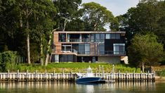 New York practice Kevin O'Sullivan + Associates has completed a waterfront house in the Hamptons with balconies for looking out at the sunset. The practice was approached after the clients had discovered the site in a small cove in the Hamptons village of Sag Harbor. Hamptons House, The Hamptons, Cedar Shingles, Cedar Siding, Sauna Room, Harbor House, Concrete Fireplace, Sag Harbor, Waterfront Homes