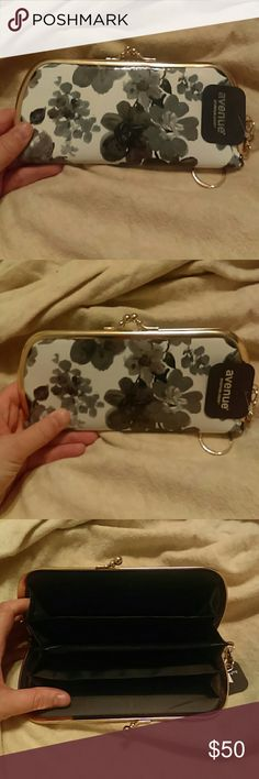 Beautiful Floral Patent Clutch In like new condition. Patent black and white floral print  and gold metal hardware. New with the tag Avenue Bags Clutches & Wristlets