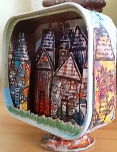 A whole village in an altered tin can by Titbelsoeur