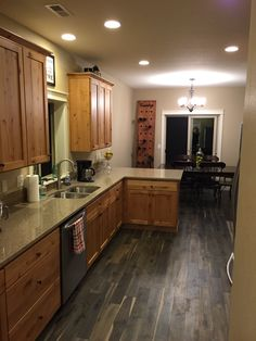 Honey Oak Kitchen Cabinets With Gray Pergo Willow Lake